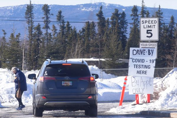 A sign directing patients to drive-by COVID-19 testing in the parking lot of the Chief Andrew Isaac Health Center in Fairbanks, Alaska Tuesday afternoon, March 31, 2020. (Photo by Eric Engman)