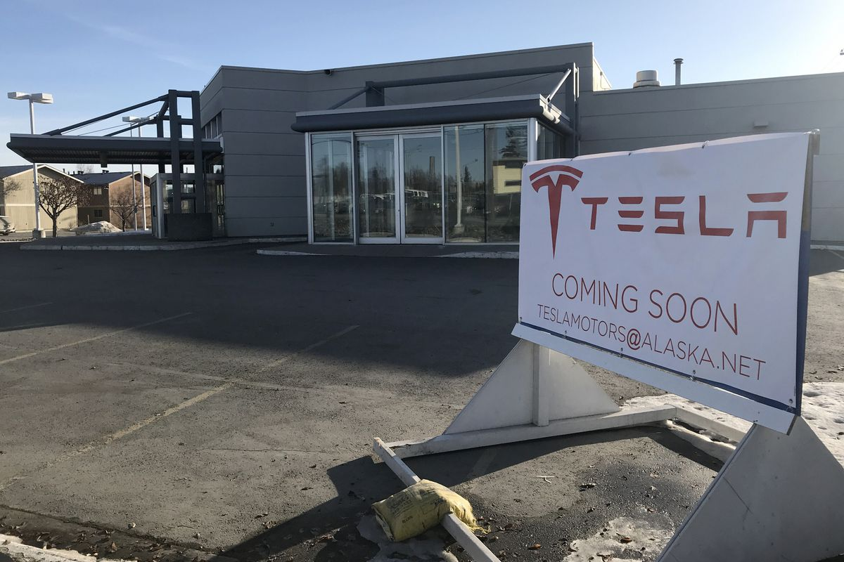 A Tesla sign on Gambell Street near East Ninth Avenue in front of a former auto dealership in Anchorage March 26, 2019. A person reached via the email address on the sign confirmed it's a prank. (Annie Zak / ADN)