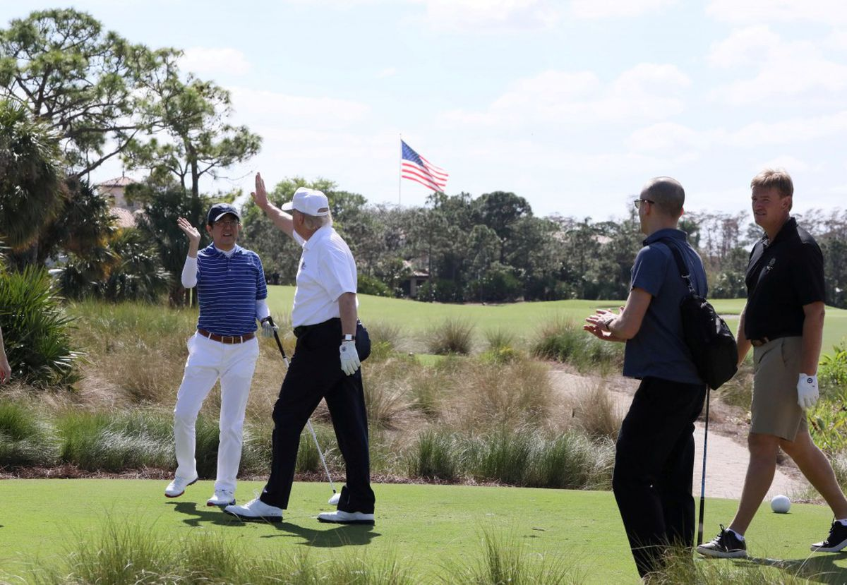 Japanese Prime Minister Shinzo Abe and President Donald Trump at Trump International Golf Club in West Palm Beach, Florida, February 11, 2017. Cabinet Public Relations Office/Handout via Reuters