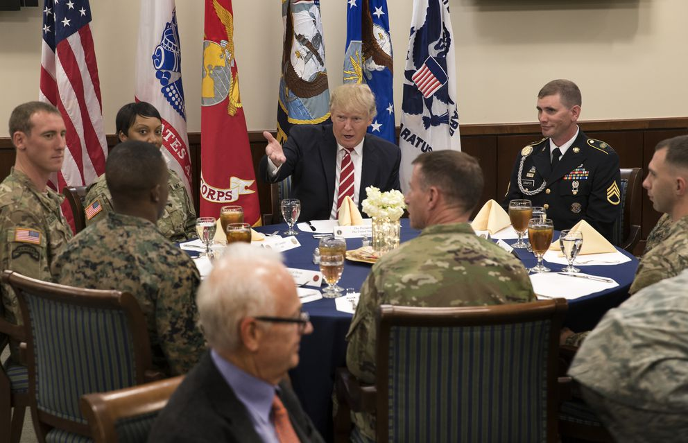 President Donald Trump dines with officers and enlisted soldiers during a visit to U.S. Central Command at MacDill Air Force Base in Tampa., Fla., on Monday. (Stephen Crowley/The New York Times)