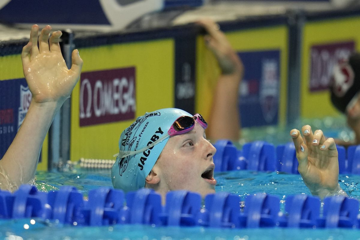 Lydia Jacoby reacts after setting a national age-group record in the women's 100-meter breaststroke Monday at the U.S. Olympic swim trials in Omaha, Nebraska. (Jeff Roberson / Associated Press)