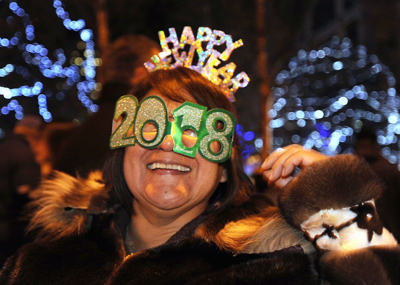 Margaret Pohjola celebrates the new year at Town Square Park on Sunday, Dec. 31, 2017.  (Bill Roth / ADN)