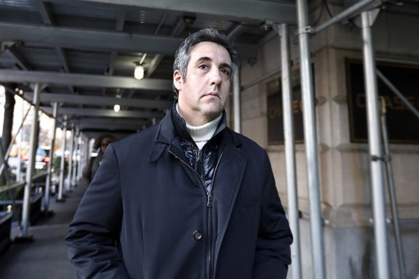 FILE - In this Dec. 7, 2018 file photo, Michael Cohen, former lawyer to President Donald Trump, leaves his apartment building in New York. Cohen is acknowledging that he paid a technology company to falsely improve Trump's standing in two online polls. (AP Photo/Richard Drew, File)