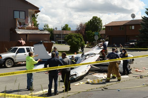 A small plane clipped a corner of a duplex on the corner of Orion Circle and Cosmic Circle and ended up in the middle of Orion Circle just south of Balto Park in west Anchorage, Alaska on Sunday, July 9, 2017. (Bob Hallinen / Alaska Dispatch News)
