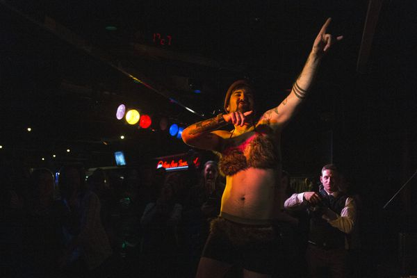 With encouragements from the roaring crowd, ten contestants shake their bodies in the Fur Rondy Fur Bikini Contest on Saturday, Feb. 25, 2017, at Chilkoot Charlie's. (Rugile Kaladyte / Alaska Dispatch News)