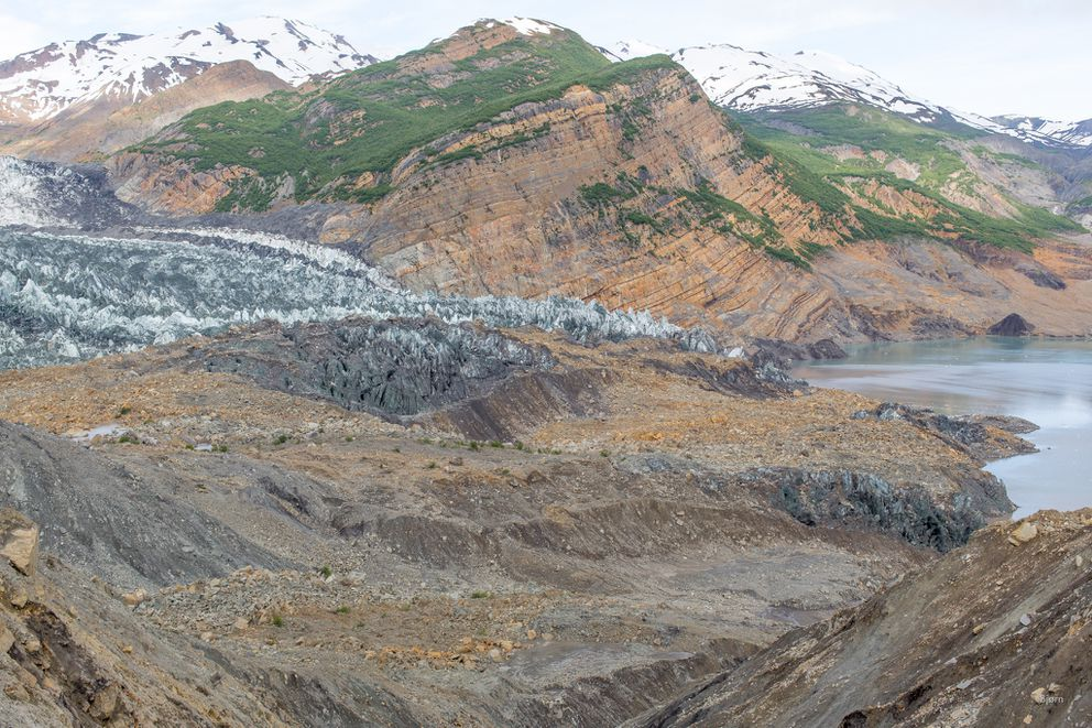 Standing in the middle of the landslide affords a tremendous view of an impossibly large event. This landslide occurred in October 2015. Some of the material slid onto the snout of the Tyndall Glacier but much of it landed in the fjord, which caused a massive tsunami. (Bjorn Olson / Ground Truth Trekking)