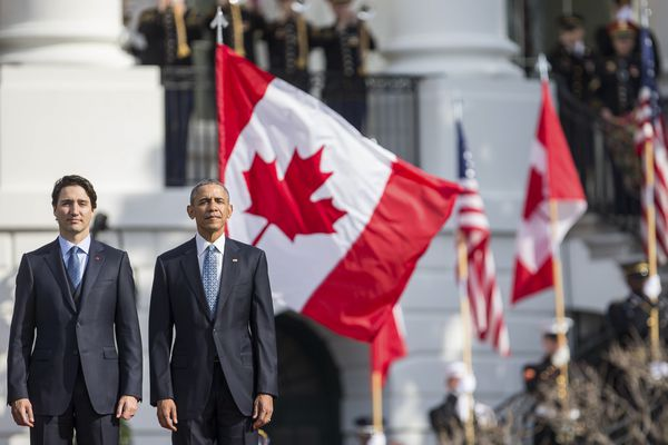 FILE -- President Barack Obama and Canadian Prime Minister Justin Trudeau during a state arrival ceremony on the South Lawn of the White House, in Washington, March 10, 2015. Garden Collective, a creative agency in Toronto, spurred a viral social media campaign, calling on Canadians to give pep talks to their friends across the border, assuring them that America is great. (Zach Gibson/The New York Times)
