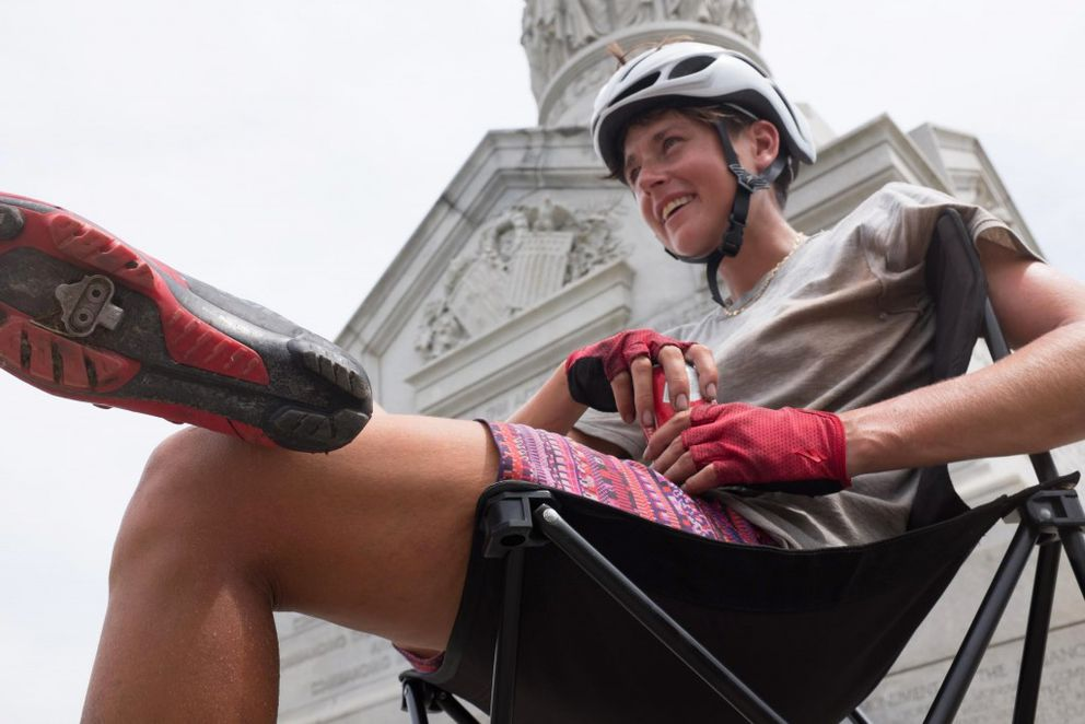 Cyclist Lael Wilcox of Anchorage recuperates at the Yorktown Victory Monument after winning the 4,200-mile Trans Am Bike Race. (Nicholas Carman)