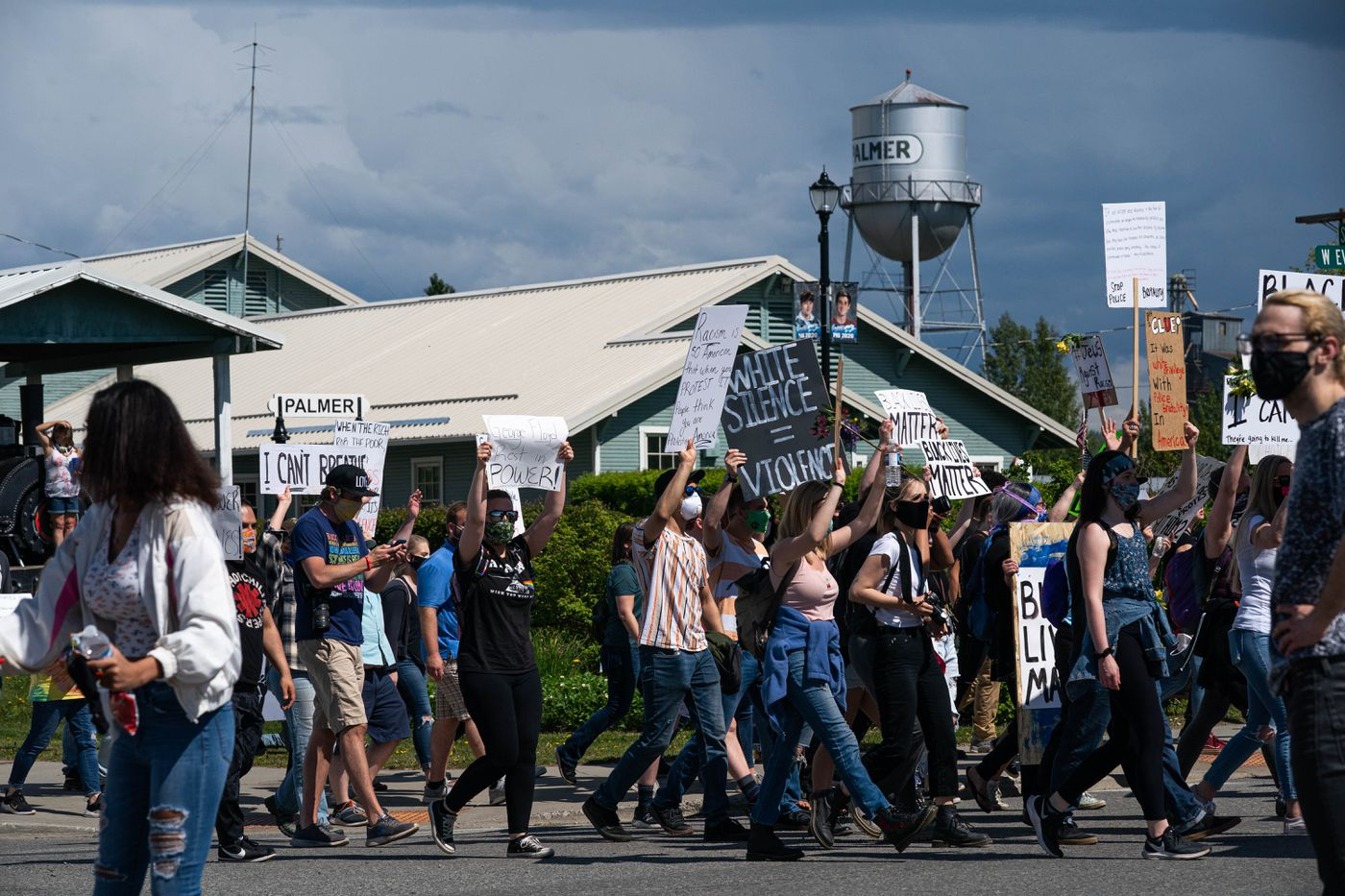 A large crowd marches through Palmer to protest racism and police brutality on Saturday, June 6, 2020. (Loren Holmes / ADN)