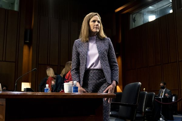 "FILE - In this Wednesday, Oct. 14, 2020 file photo, Supreme Court nominee Amy Coney Barrett departs during a break in a confirmation hearing before the Senate Judiciary Committee on Capitol Hill in Washington. On Friday, Oct. 16, 2020, The Associated Press reported on stories circulating online incorrectly asserting that when reporters asked President Donald Trump why he nominated Barrett to replace the late Supreme Court Justice Ruth Bader Ginsburg, he said Barrett is ""much better looking"" than other women who have appeared on the court and ""if people are more attractive, they get a fantastic amount of respect."" There is no evidence Trump made these comments. (Stefani Reynolds/Pool via AP)"