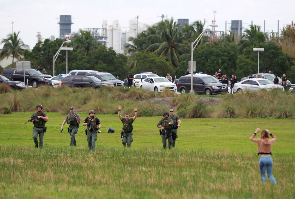 Law enforcement officers move in to verify the identity of people in this field just outside the airport perimeter following a shooting incident at Fort Lauderdale-Hollywood International Airport in Fort Lauderdale, Florida, U.S. January 6, 2017. REUTERS/Andrew Innerarity