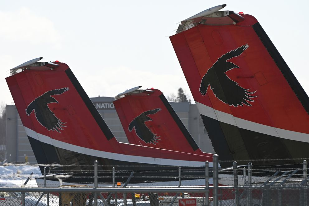 Ravn Alaska De Havilland Dash 8 aircraft were parked at corporate headquarters at Ted Stevens Anchorage International Airport on Sunday, April 5, 2020. (Bill Roth / ADN)