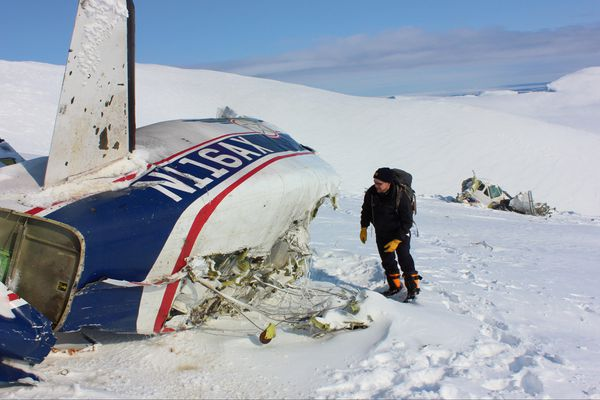 OPINION: Dangers of flying in Alaska are only made worse by lack of oversight staffing and smart decisions both before and during flights. Pictured: National Transportation Safety Board investigator Brice Banning at the site of the fatal Alaska Central Express crash northeast of Dillingham in March 2013.