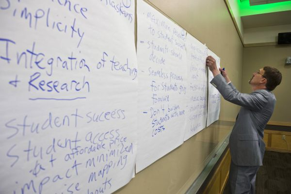 Myron Dosch, chief finance officer for University of Alaska, writes ideas on paper during the meeting. The University of Alaska Board of Regents met at UAA to discuss restructuring the university in the face of budget cuts on July 30, 2019. (Marc Lester / ADN)
