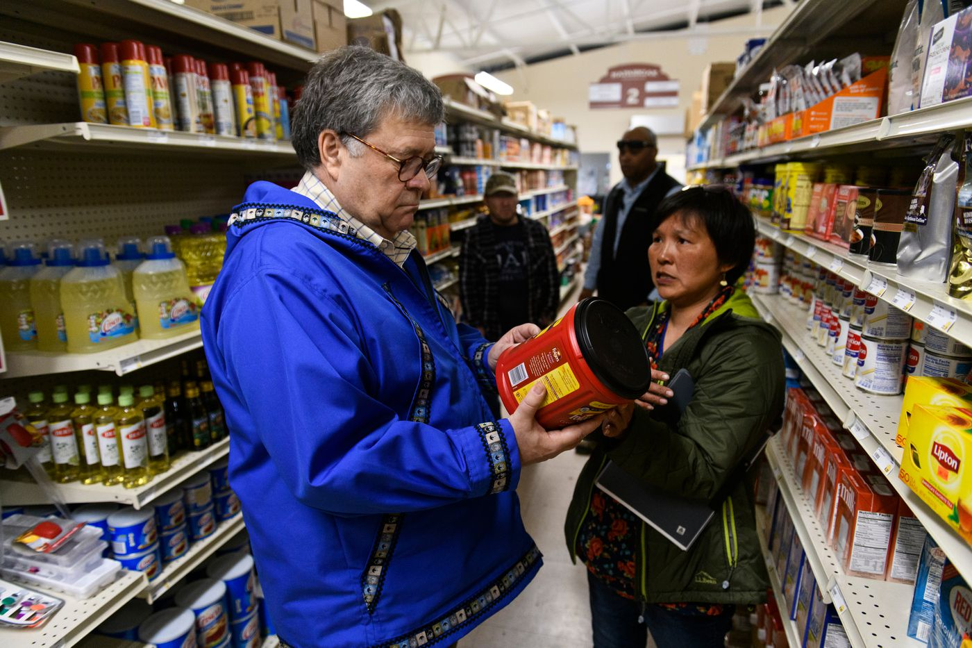 U.S. Attorney General William Barr talks about the cost of some grocery items with tribal administrator Sharon Williams during a visit to a store in Napaskiak on May 31, 2019. (Marc Lester / ADN)
