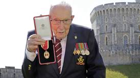 Capt. Tom Moore, 100-year-old UK veteran who walked to boost health workers, dies with COVID-19
