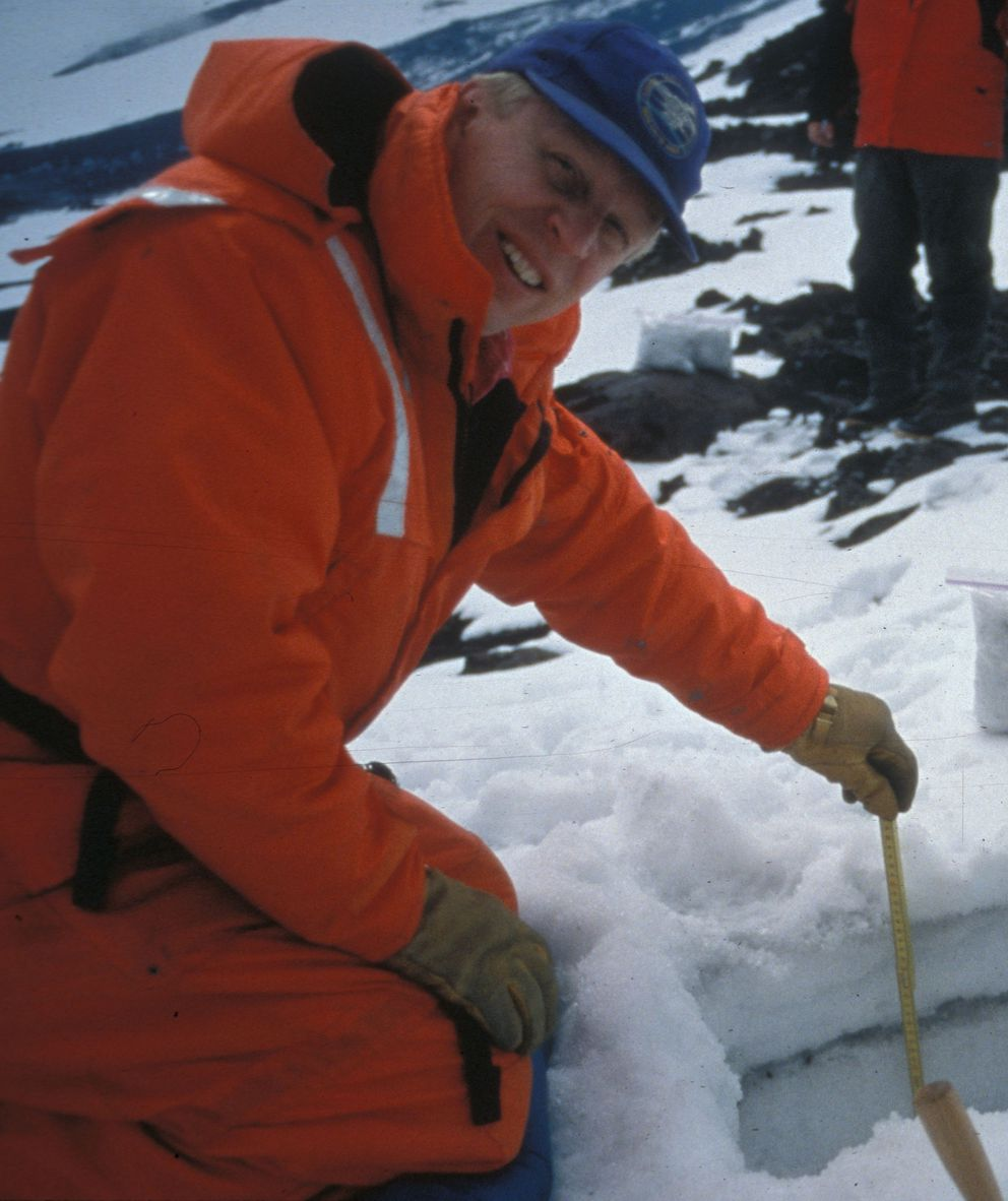 Guy Tytgat measuring ash on Shishaldin Volcano after an eruption there in the late 1990s. (Alaska Volcano Observatory photo by Jim Beget)