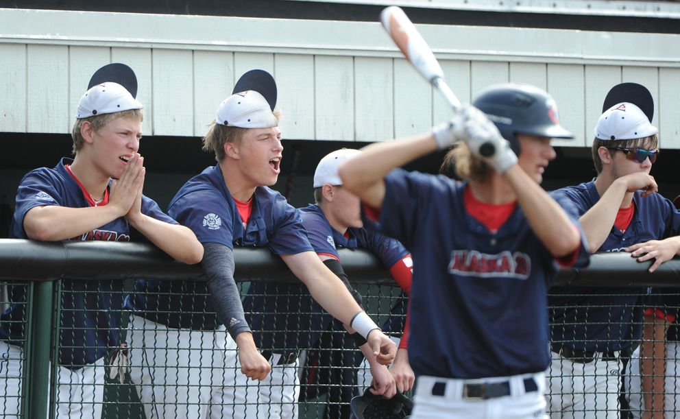 Kenai Twins players make noise from the dugout during a three-run rally at the top of the seventh inning. (Bill Roth / ADN)