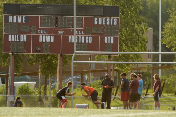 The Dimond high football team runs a no pads football practice at Dimond High in Anchorage, AK on Friday, August 31, 2018. The team returned to the field after a suspension that started August 22. (Bob Hallinen / ADN)