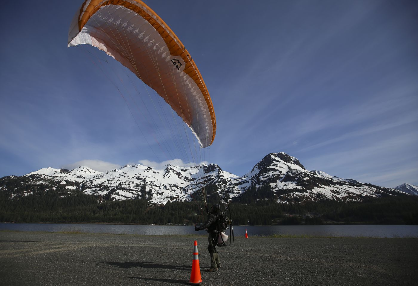 Leo Vargas attempts to take off with his powered paraglider from Cordova's city airstrip on Tuesday, May 18, 2021. (Emily Mesner / ADN)