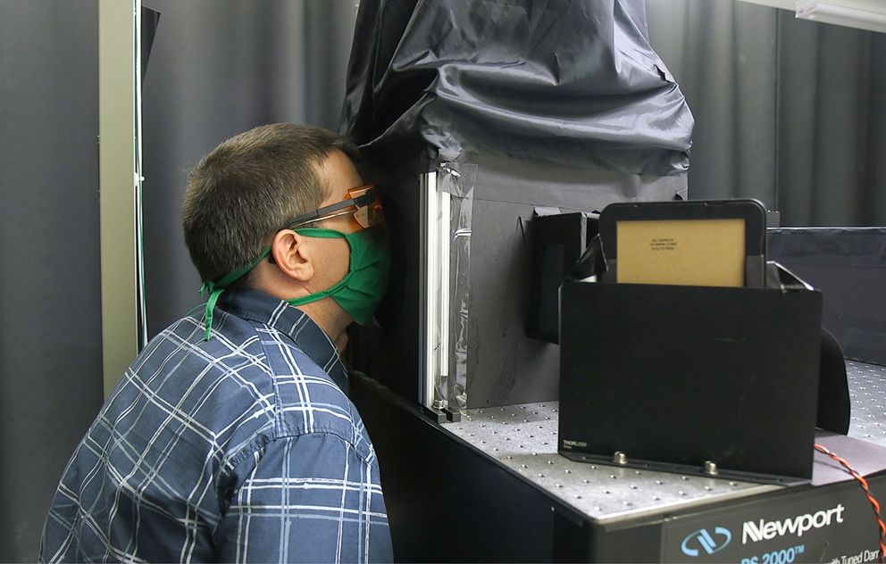 Martin Fischer developed a simple, low-cost technique to visualize the effect of face masks on droplet emissions during normal wear. (Shawn Rocco/Duke Health)