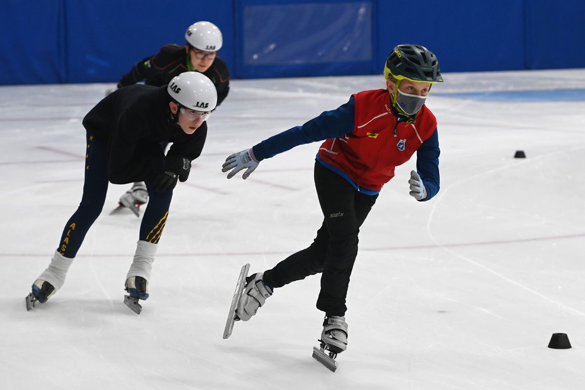 Julia Oswald, 11, Duncan Moreland, 13, and Jojo Leonard, 11, skate laps Wednesday on the first day of short track speedskating summer practice at the Royal Business Systems Ice Center. (Bill Roth / ADN)