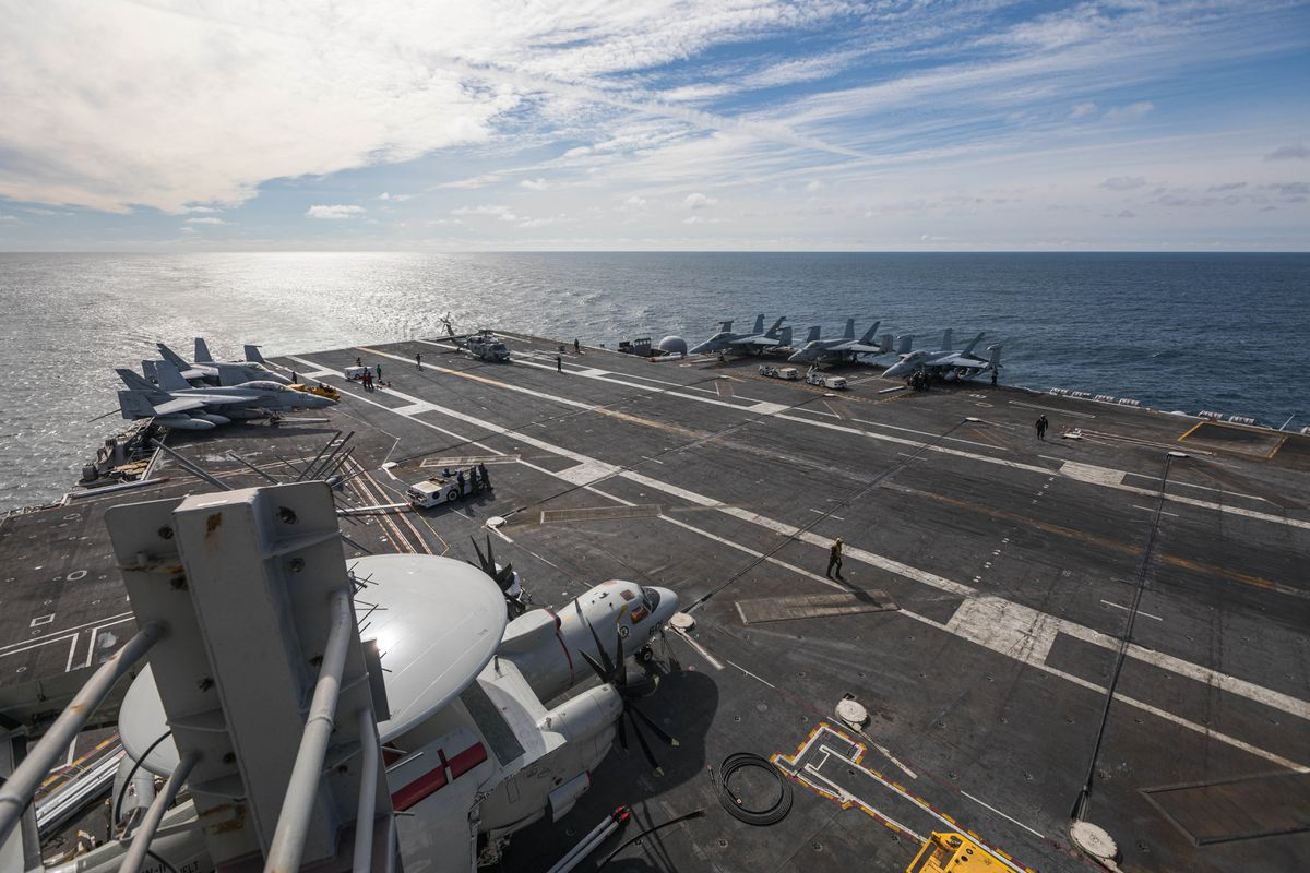 Aircraft sit on the flight deck of the USS Theodore Roosevelt on Wednesday, May 23, 2019. Carrier Air Wing 11 is attached to the Roosevelt, and is comprised of strike fighters, electronic warfare aircraft, command and control aircraft, and helicopters used for both search and rescue and warfare. (Loren Holmes / ADN)