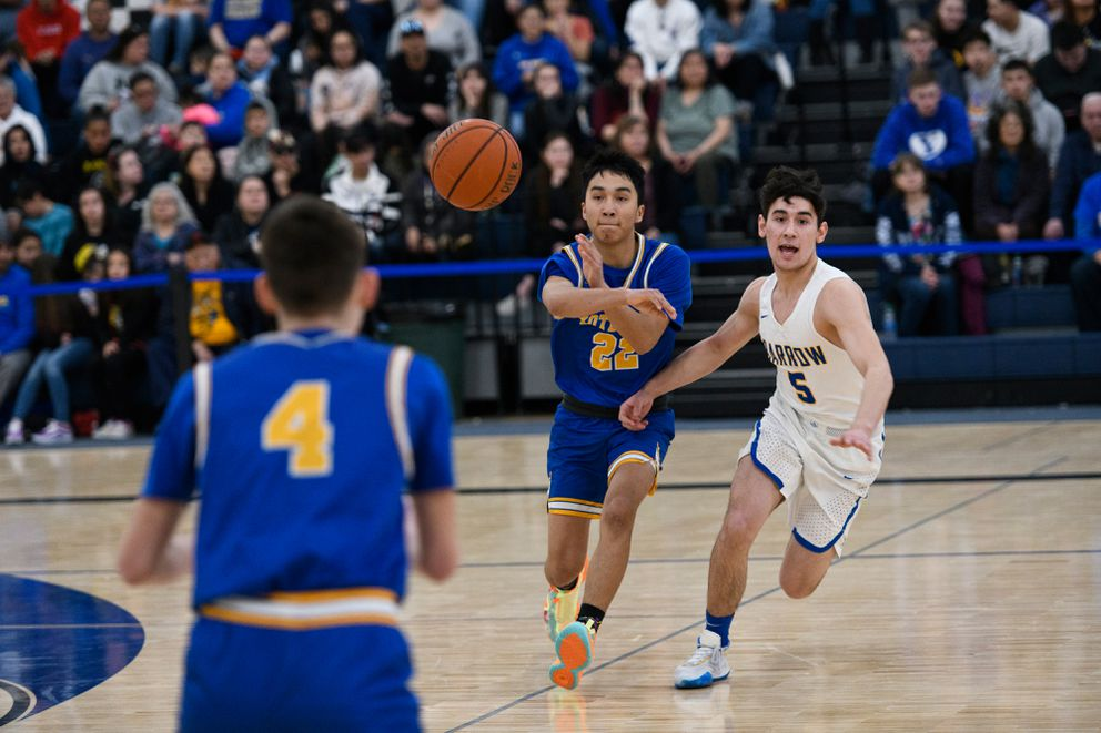 Kotzebue's Devin Sheldon passes to teammate Aiden Ivanoff during a game against Barrow in the Class 3A Western Conference tournament at Lumen Christi High School on Friday. (Marc Lester / ADN)
