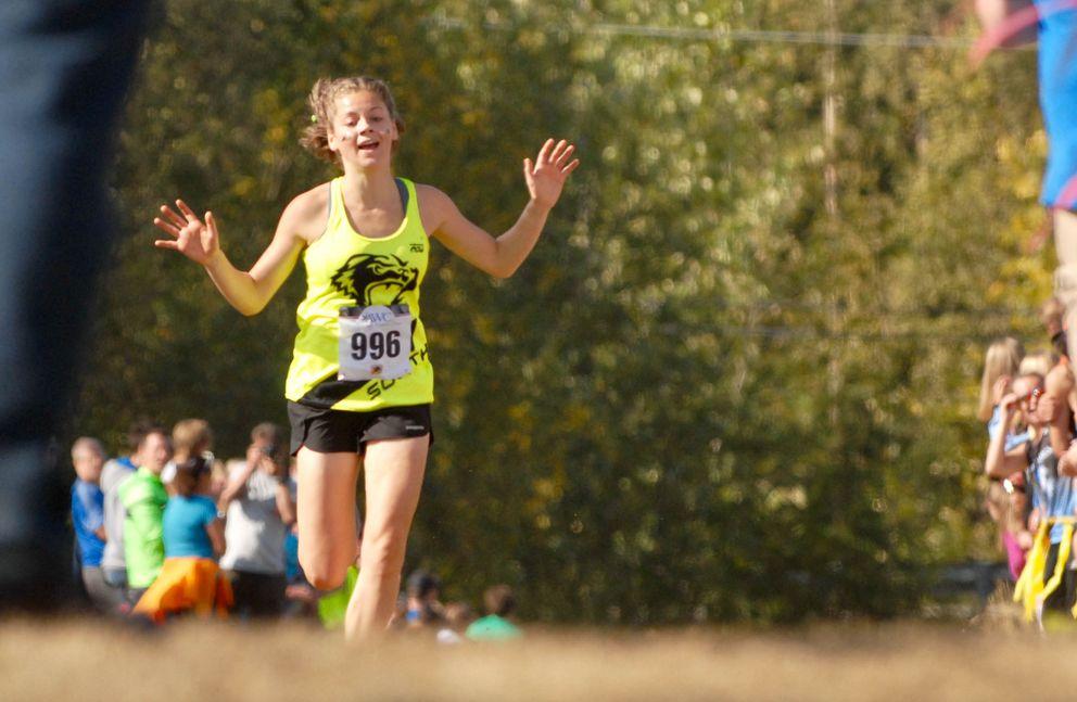 South's Ava Earl raises her arms after winning the varsity girls race. (Matt Tunseth / ADN)