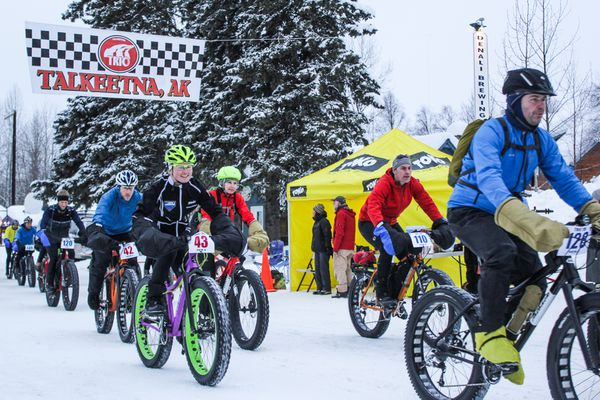 Racers hit the trails at the start of a fatbike race in Talkeetna, Alaska, in 2013.