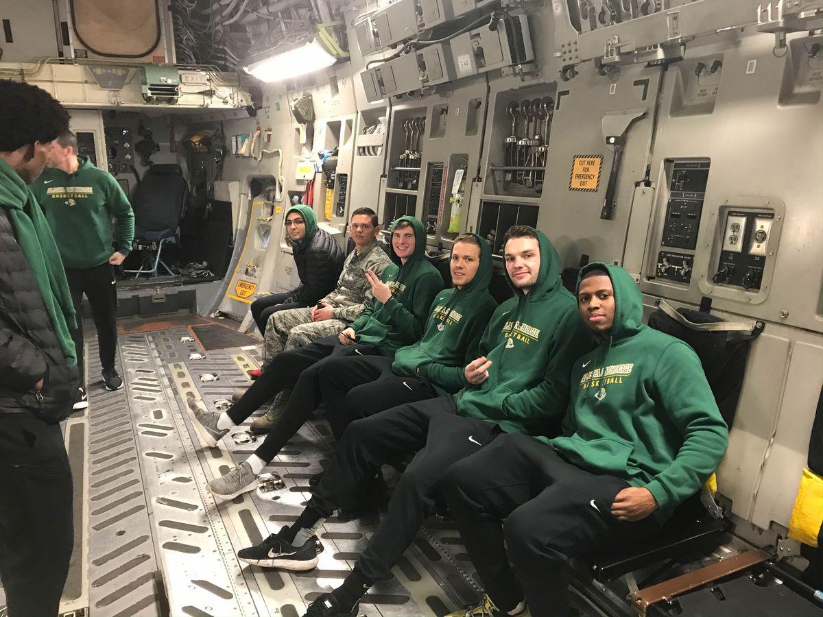 From left: Danilo Guzman, senior airman Andrew Gecsedi, Eric Jenkins, Jack MacDonald, Tyler Brimhall and Tyrus Hosley check out a cargo jet Wednesday at Joint Base Elmendorf-Richardson. (Ian Marks / UAA)