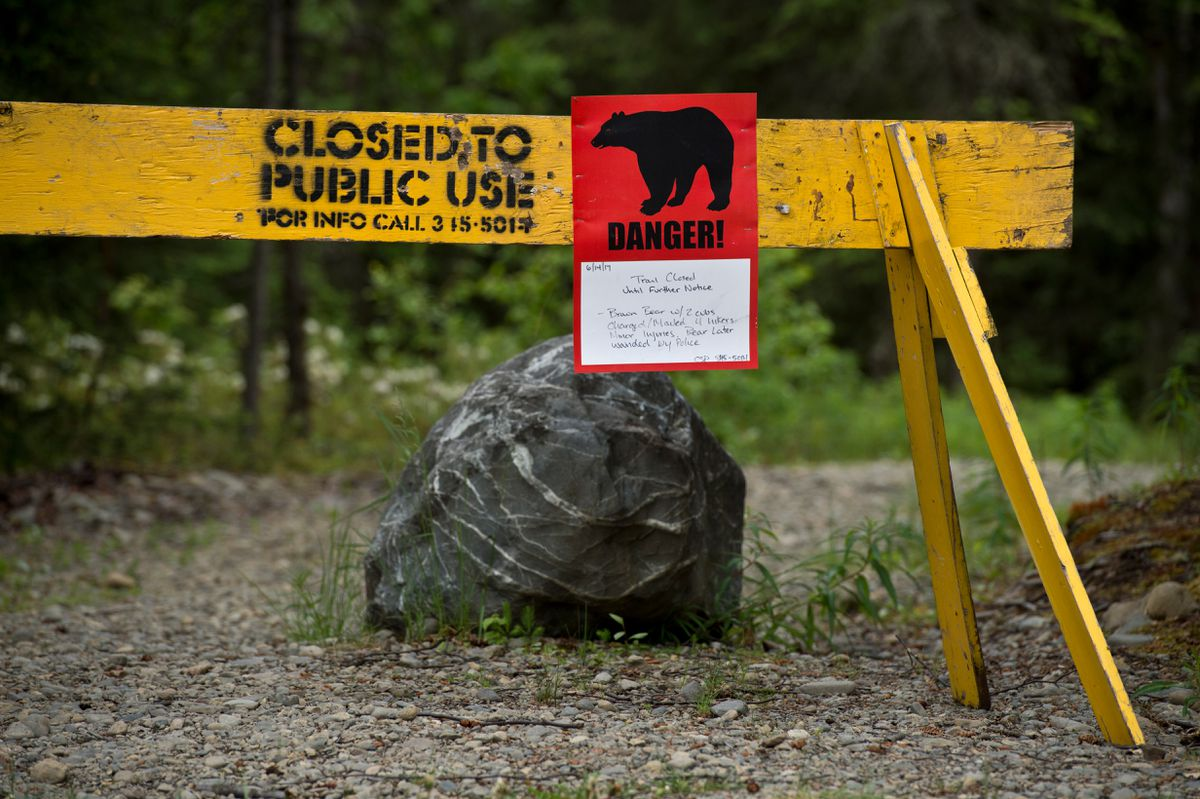 A trail head remains closed from the Eagle River campground in Chugach State Park on Tuesday. An encounter last week with a grizzly bear sow with three cubs left three people with injuries, police said.  (Marc Lester / Alaska Dispatch News)