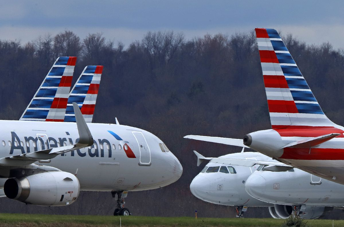In this March 31, 2020, file photo, American Airlines planes are stored at Pittsburgh International Airport in Imperial, Pa. (AP Photo/Gene J. Puskar, File)
