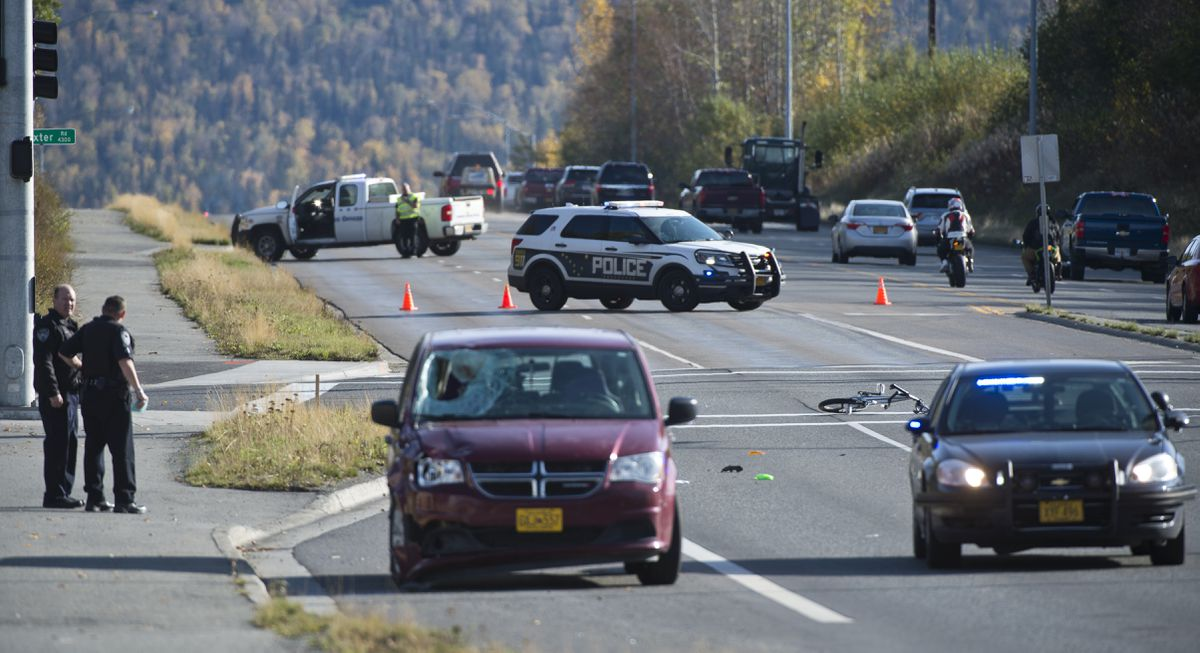 Anchorage Police respond to the scene of collision involving a vehicle and a bicyclist on Tudor Road near Baxter Road on September 23, 2019. (Marc Lester / ADN)