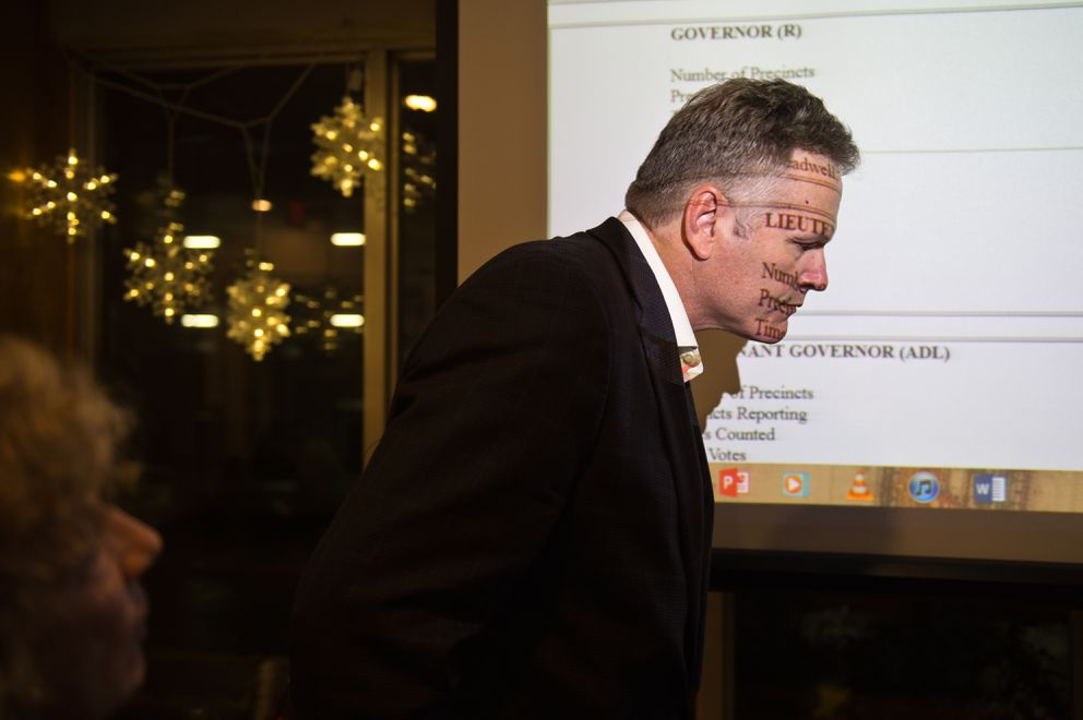 Election results are projected on MIke Dunleavy while he talks with others at the Aviator Hotel on August 21, 2018. (Marc Lester / ADN)