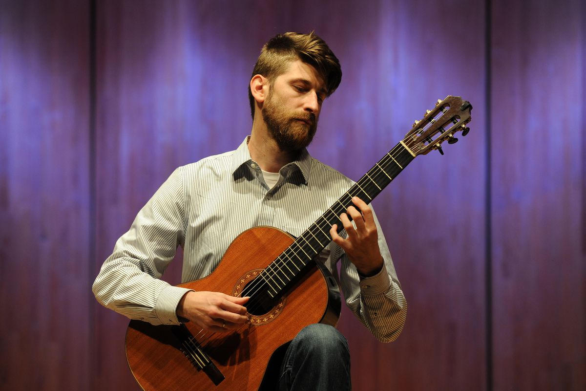 Armin Abdihodzic is an assistant professor at the University of Alaska Anchorage. He has organized a guitar symposium featuring workshops and public concerts. He was photographed in the recital hall in the Fine Arts Building on Tuesday, Sept. 20, 2016. (Erik Hill / Alaska Dispatch News)