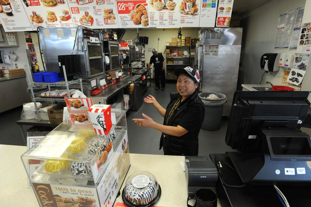 Tuoi Yungbauer behind the counter at the Midtown Anchorage KFC, where she has worked since 1976. (Bill Roth / Alaska Dispatch News)