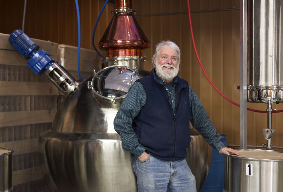 Owner Patrick Levy stands in front of his equipment at the Fairbanks Distilling Company. The company was able to move into the former City Hall building in late July of 2014. (Rugile Kaladyte / Alaska Dispatch News)