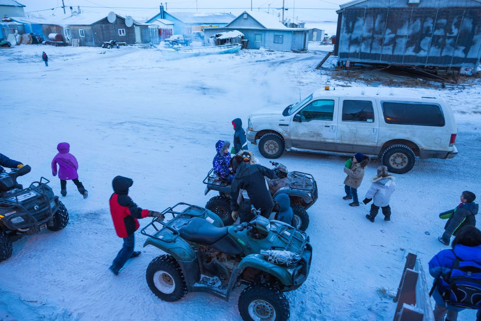 A 2012 file photo shows children leaving Kivalina's McQueen School after classes. (Loren Holmes / Alaska Dispatch News)
