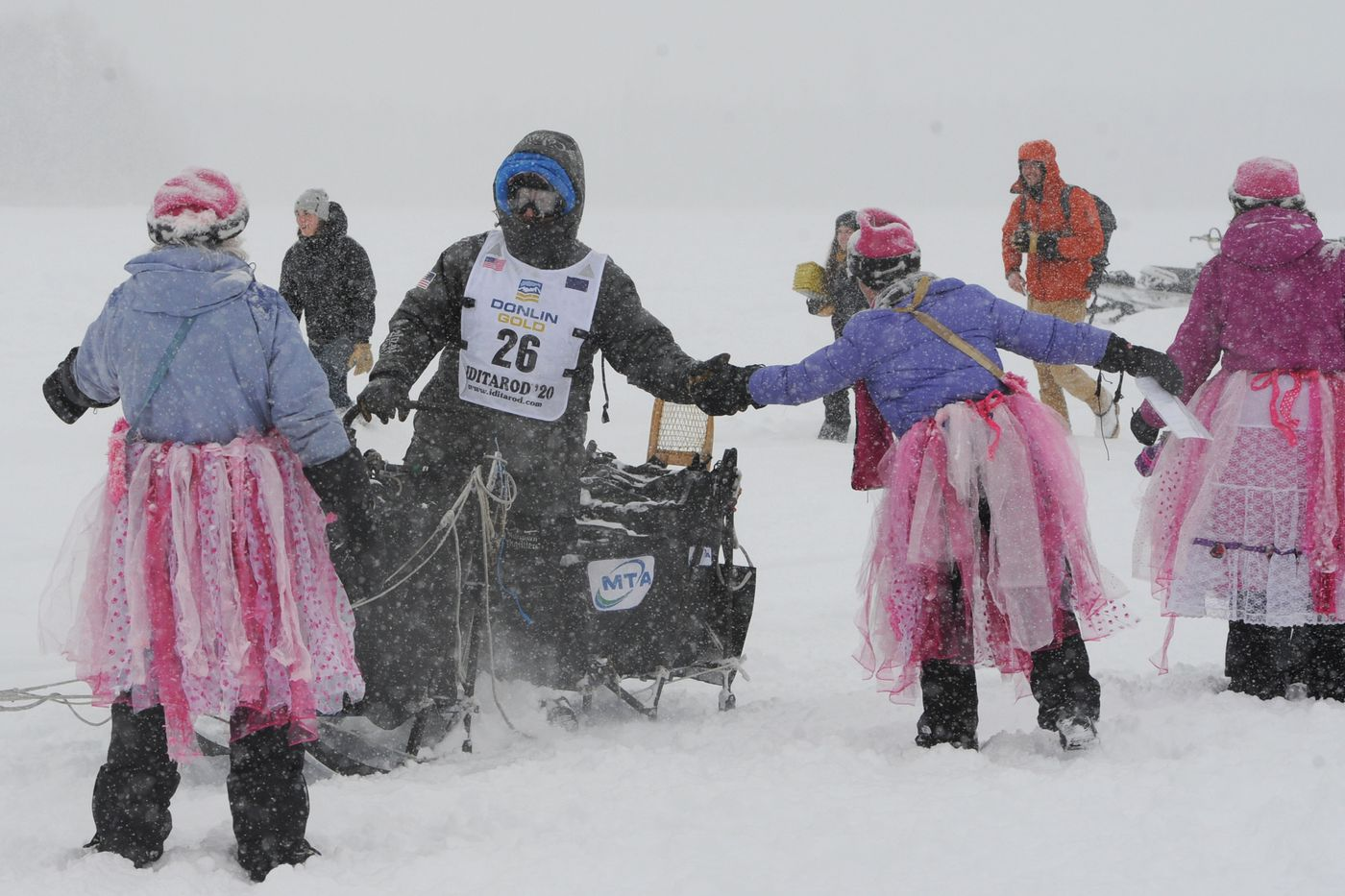 Four-time Iditarod champion Martin Buser is greeted by fairies during the restart of the Iditarod Trail Sled Dog Race in Willow on Sunday. (Bill Roth / ADN)