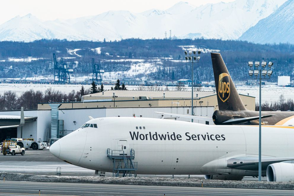 UPS cargo airplanes at the Ted Stevens Anchorage International Airport on Friday, March 27, 2020. Behind are cranes that load and unload containers at the Port of Alaska. (Loren Holmes / ADN)
