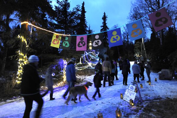 People walked the Mize Loop at Kincaid Park to view 30 trees that were decorated for Nordic Skiing Association of Anchorage's second annual Solstice Tree Tour on Sunday, Dec. 17, 2017. Local businesses sponsored trees for the unique celebration of Winter Solstice and the return of longer days. (Bill Roth / ADN)