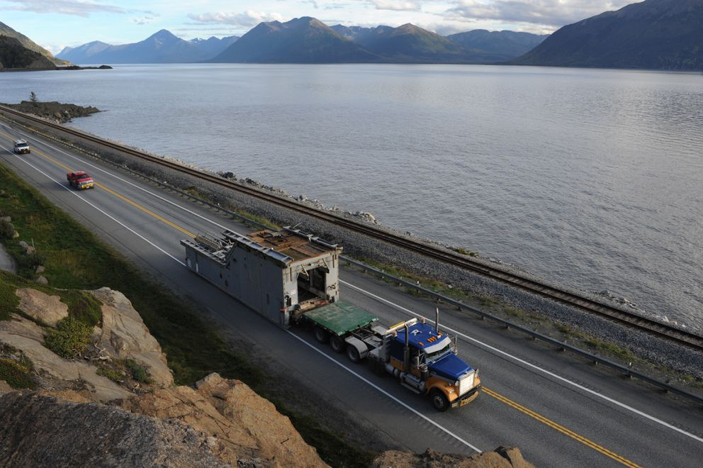 The substructure of the 2-million-pound Tolsona No. 1 drill rig passes by McHugh Creek along Turnagain Arm on its journey from the Kenai to the Tolsona drilling pad located near Glennallen on Sept. 13. (Bill Roth / ADN file)