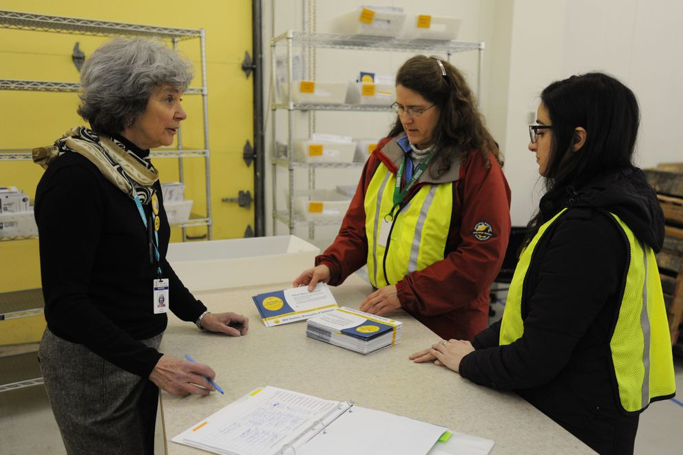 Election worker Lois Hansen receives ballot envelopes brought to the MOA Election Center by Drop Box workers Karen Walker and Elaine Leibert on Monday, March 19, 2018. (Bill Roth / ADN)