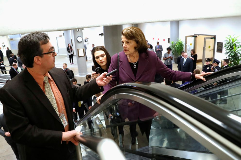 FILE: Reporters trail U.S. Senator Dianne Feinstein (D-CA) as she arrives ahead of a vote on a bill to renew the National Security Agency's warrantless internet surveillance program, at the U.S. Capitol in Washington. REUTERS/Jonathan Ernst