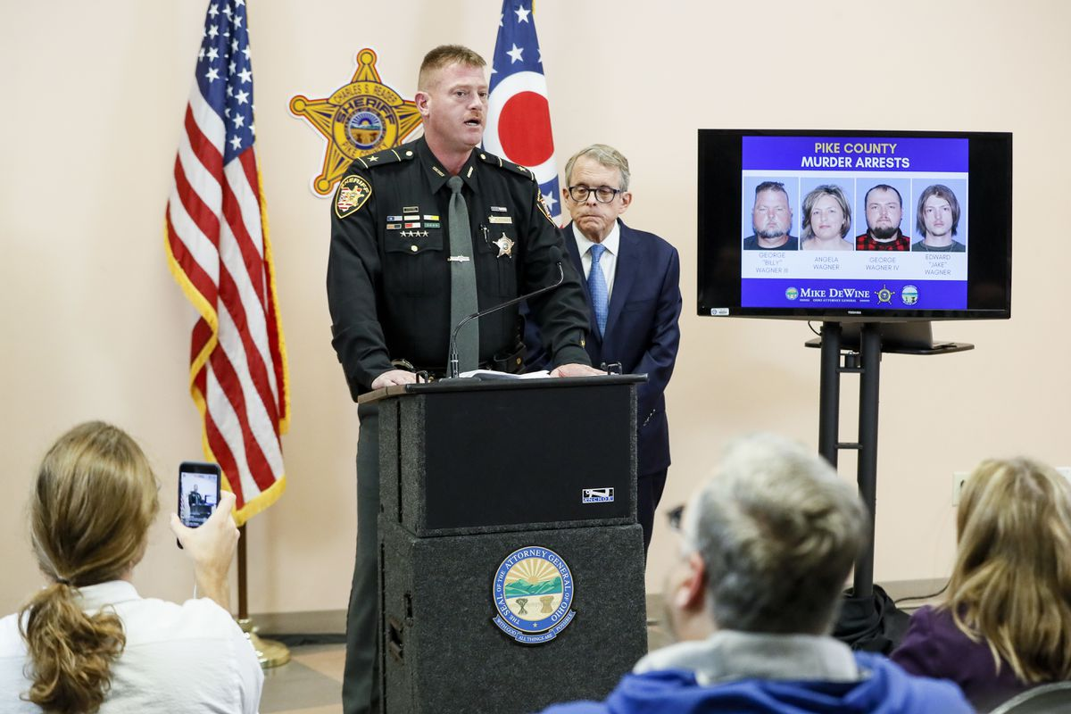 Pike County Sheriff Charles Reader, left, speaks alongside Ohio Attorney General Mike DeWine, right, during a news conference to discuss developments into the slayings of eight members of one family in rural Ohio two years ago, Tuesday, Nov. 13, 2018, in Waverly, Ohio.A family of four, the Wagner family, who lived near the scenes of the killings, was arrested Tuesday. (AP Photo/John Minchillo)