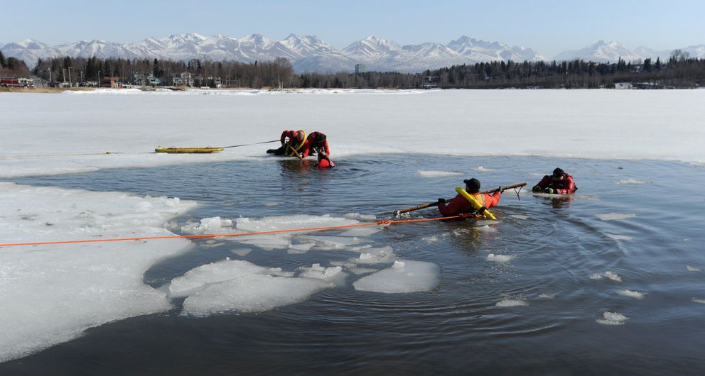 Anchorage Fire Department first responders from Station 4 practiced thin ice rescues at Westchester Lagoon on Sunday, March 31, 2019. (Bill Roth / ADN)