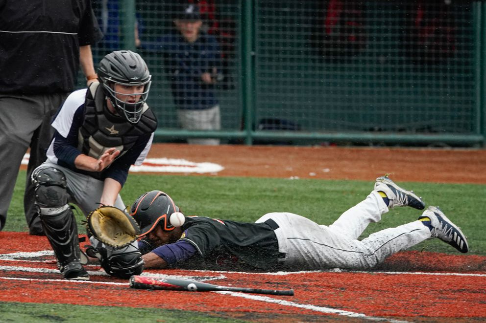 Shawn Jones beats the throw to the plate to score the first run in West's 3-0 victory over Juneau. (Loren Holmes / ADN)