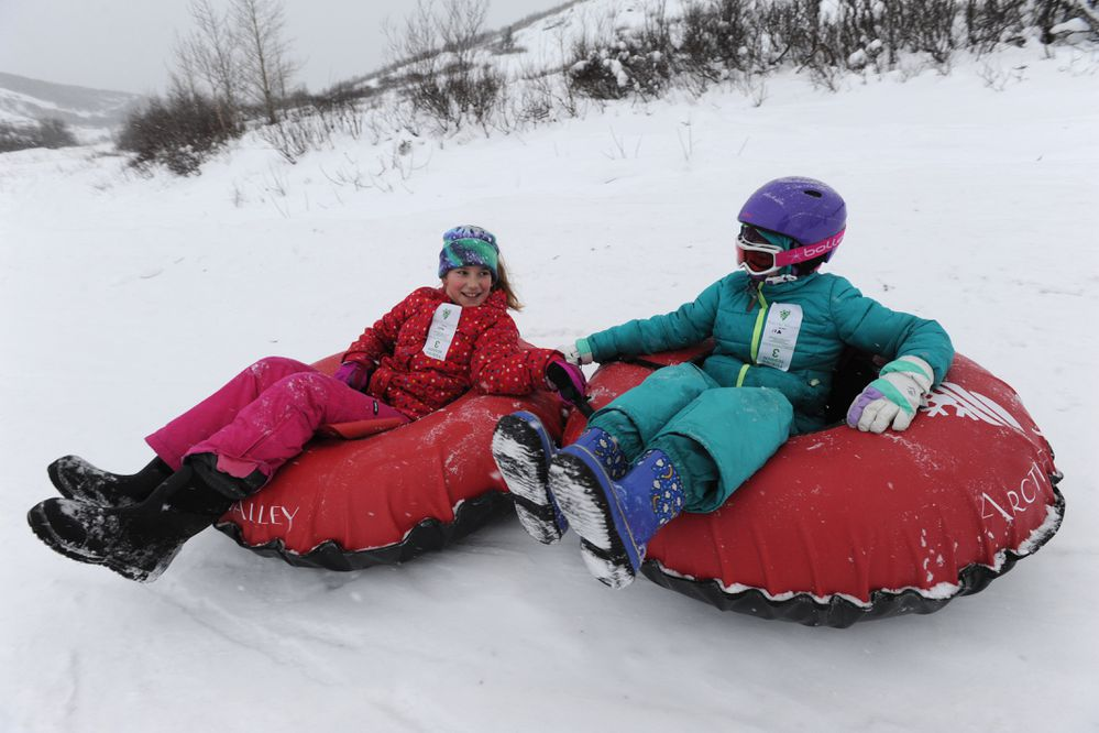Tallulah Winter and Aubrey Winchester, both 10-years-old, slide down the Tube Park at Arctic Valley Ski Area on Sunday, Dec. 16, 2018. Arctic Valley tentatively plans to open to skiers and snowboarders on Saturday, Dec. 22. (Bill Roth / ADN)