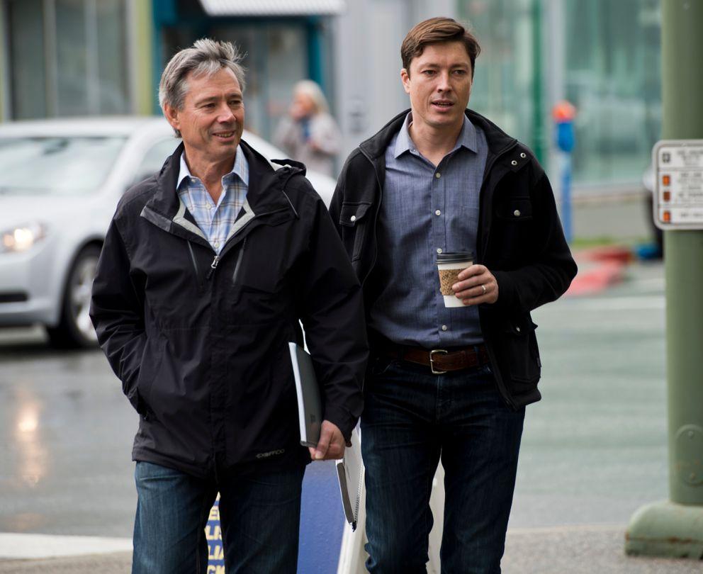 John Binkley, left, and son Ryan Binkley walk toward the Old Federal Building downtown before an Alaska Dispatch News bankruptcy meeting. (Marc Lester / Alaska Dispatch News)